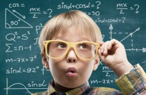 Kid. Thinking child with a blackboard in the backgroun